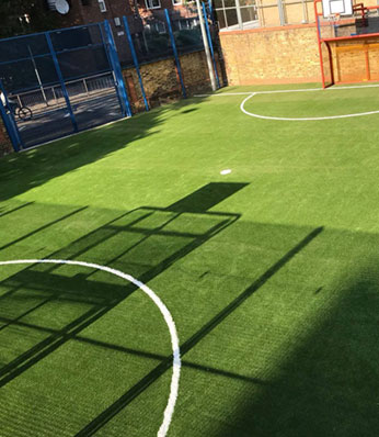 Playground plastic grass installation