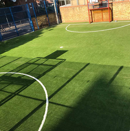 Astro turf grass installation on a plan ground