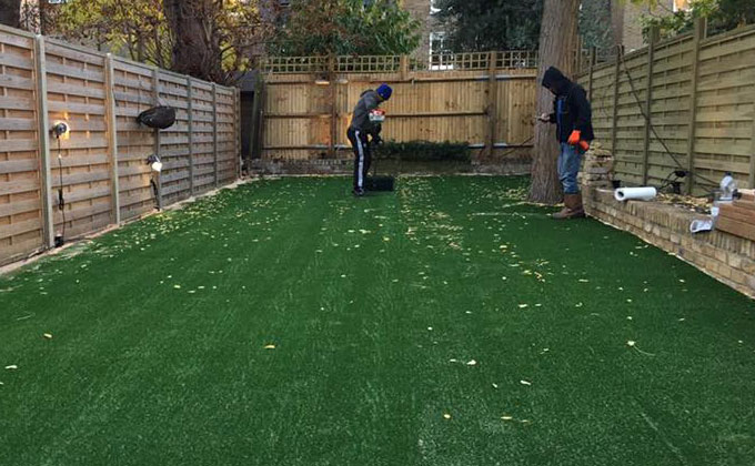 Astrolondon doing initial clean on a synthetic grass