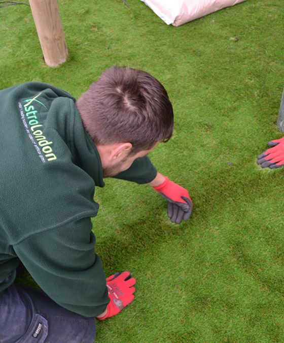 Astrolondon inspecting synthetic grass
