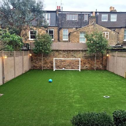 Fake grass insallation in a Brent Playground