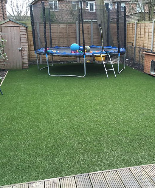 Synthetic grass insallation in a Hackney playground