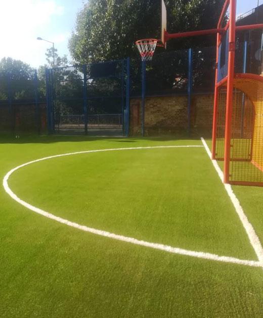 Artificial grass insallation in a Richmond playground