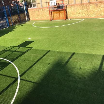 Fake grass insallation in a Harrow Playground