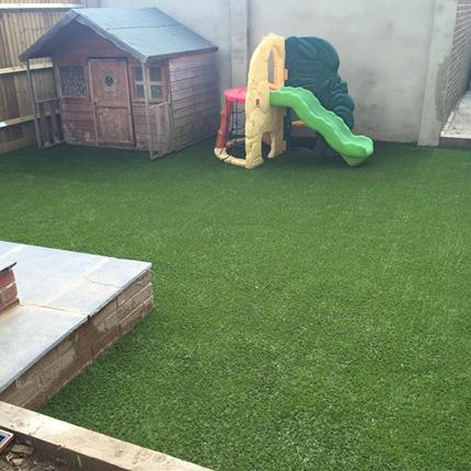 Artificial grass insallation in a Merton Playground
