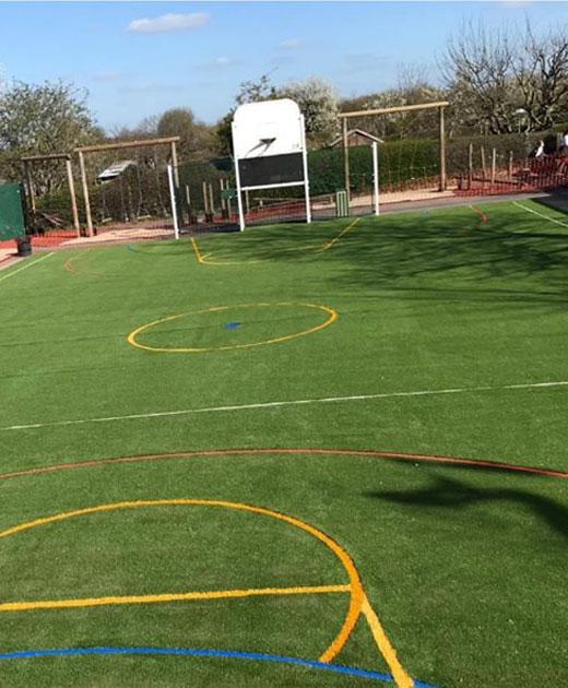 Plastic grass insallation in a Croydon Playground
