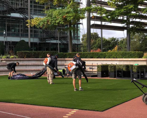 Astro team cleaning artificial grass maintenance