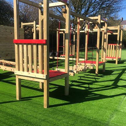 Fake grass insallation in a Croydon school/college